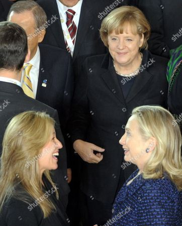Us Secretary of State Hillary Clinton (front-r) and Her Spanish Counterpart Trinidad Jimenez (front-l) Chat As German Chancellor Angela Merkel (c) Looks on During the International Afghanistan Conference at the World Conference Center Bonn (wccb) in Bonn Germany 05 December 2011 the Meeting is Expected to Focus on the Security Handover to Afghan Forces As Well As International Aid and Political Commitments to the Country After 2014 Which is the Deadline For Nato-led Forces to Withdraw From the Country Germany Bonn