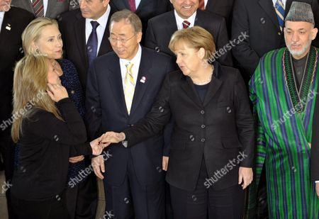 (l-r) Us Foreign Minister Hillary Clinton Spanish Foreign Minister Trinidad Jimenez Un Secretary-general Ban Ki Moon German Chancellor Angela Merkel and Afghanistan President Hamid Karzai Pose During the International Afghanistan Conference at the World Conference Center Bonn (wccb) in Bonn Germany 05 December 2011 the Meeting is Expected to Focus on the Security Handover to Afghan Forces As Well As International Aid and Political Commitments to the Country After 2014 Which is the Deadline For Nato-led Forces to Withdraw From the Country Germany Bonn