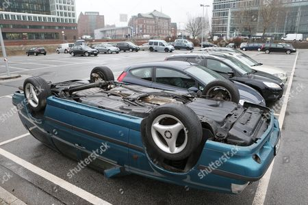 An Installation of German Visual Artist Hans-peter Feldmann a Car Lying Upside Down is Featured at a Public Parking Lot Next to the Deichtorhallen in Hamburg Germany 12 April 2013 Th Deichtorhallen Present Pictures Sculptures and Installations of the German Artist Until 02 June 2013 Germany Hamburg