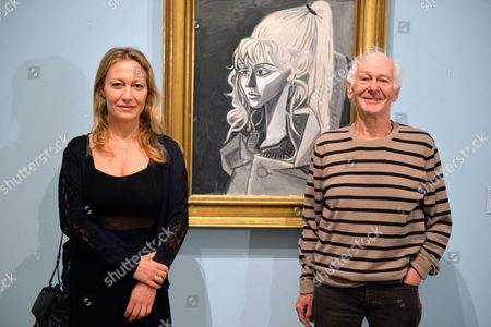 Grand-daughter of Spanish Painter Picasso Diana Widmaier Picasso (l) and Former Husband of Sylvette Davis Toby Jellinek (r) Pose For Photographs in Front of a Sylvette Painting on Display at the 'Sylvette Sylvette Sylvette: Picasso and the Model' Exhibition at Kunsthalle in Bremen Germany 07 April 2014 Germany Bremen