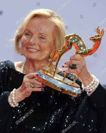 Stock Photo of German Actress Ruth Maria Kubitschek Poses with the Bambi Trophy in the Press Room After the Award Ceremony in Wiesbaden Germany 10 November 2011 the Bambis Are the Main German Media Awards and Are Presented For the 63rd Time Germany Wiesbaden