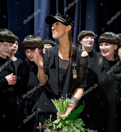 German Fashin Designer Esther Perbandt (c) Acknowledges the Applause of the Visitors After Her Show While Being Flanked by Members of a Choir During the Berlin Fashion Week in Berlin Germany 15 January 2014 Fall-winter 2014/15 Collections Are Presented at the Event From 14 to 17 January Germany Berlin