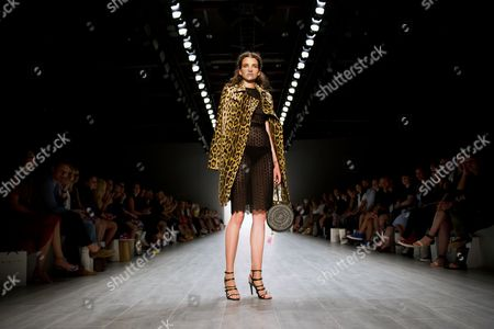 Stock Photo of A Model Presents a Creation From the Spring/summer 2015 Collection by Greek Designer Dimitrios Panagiotopoulos For His Label Dimitri at the Mercedes-benzáfashion Week in Berlin ágermany 10 July 2014 the Event Runs From 08 to 11 July Germany Berlin