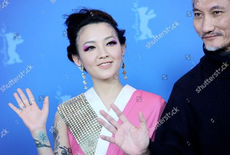 Chinese Director Tsui Hark and Actress Fan Hsiao Shuan (l) Pose at a Photocall For 'The Flying Swords of Dragon Gate' During the 62nd Berlin International Film Festival in Berlin Germany 17 February 2012 the Movie is Presented out of Competition at the 62nd Berlinale That Runs From 09 to 19 February Germany Berlin
