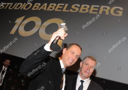 Studio Babelsberg Ceos Carl L Woebcken (r) and Christoph Fisser Pose with the Berlinale Camera Prize at the Film Studio Babelsberg in Potsdam Germany 12 February 2012 a Gala at the Potsdam Marlene Dietrich Arena Will Celebrate the Studio's 100th Anniversary Germany Potsdam