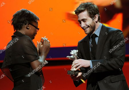 Actress Rachel Mwanza (l) Receives the Award For Best Actress (silver Bear) For the Movie 'War Witch' ('rebelle') From Jury Member and Us Actor Jake Gyllenhaal During the Awarding Ceremony of the 62nd Berlin International Film Festival in Berlin Germany 18 February 2012 a Total of 18 Movies Are Competing For the Berlinale's Golden Bear For Best Picture the 62nd Berlinale Takes Place From 09 to 19 February Germany Berlin