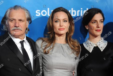 Us Actress and Director Angelina Jolie (c) Serbian-born Actor Rade Serbedzija (l) and Bosnian Actress Zana Marjanovic Arrive For the Charity Event Cinema For Peace Within the Scope of the 62nd Berlinale in Berlin Germany 13 February 2012 Since 2002 Cinema For Peace Has Been a Worldwide Initiative Promoting Humanity Through Film While Inviting Members of the International Film Community to Attend the Annual Cinema For Peace Award-gala-night During the Berlin International Film Festival Germany Berlin