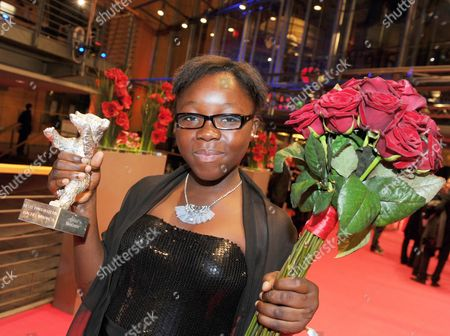 Congolese Actress Rachel Mwanza Poses with the Award For Best Actress (silver Bear) For the Movie 'War Witch' ('rebelle') After the Awarding Ceremony of the 62nd Berlin International Film Festival in Berlin Germany 18 February 2012 a Total of 18 Films Competing For the Berlinale's Prestigious Golden Bear For Best Picture About 400 Films Are Shown Every Year As Part of the Berlinale's Public Programme Germany Berlin