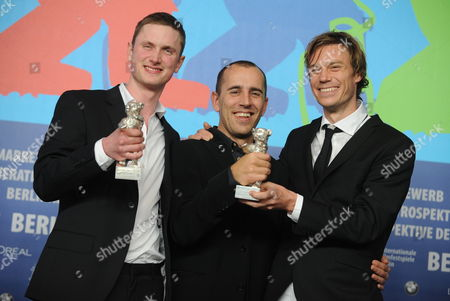 Actor Mikkel Boe Folsgaard (l) Poses with the Award For Best Actor (silver Bear) For the Movie 'A Royal Affair' ('en Kongelig Affære') with Danish Director Nikolaj Arcel (c) and Writer Rasmus Heisterberg Winner of the Award For Best Script (silver Bear) For the Movie 'A Royal Affair' ('en Kongelig Affære') During the Press Conference After the Closing Ceremony of the 62nd Berlin International Film Festival in Berlin Germany 18 February 2012 a Total of 18 Films Competing For the Berlinale's Prestigious Golden Bear For Best Picture About 400 Films Are Shown Every Year As Part of the Berlinale's Public Programme Germany Berlin