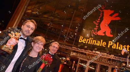 Romanian Director Calin Peter Netzer (l) and Producer Ada Solomon (2-l) Pose with Their Golden Bear Award For Best Film For 'Pozitia Copilului' (child's Pose)during the Closing Ceremony of the 63rd Annual Berlin International Film Festival in Berlin Germany 16 February 2013 the Berlinale Runs From 07 to 17 February Germany Berlin