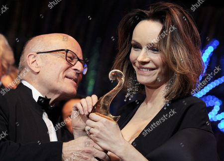 Italian Actress and Producer Francesca Neri Receives From Producer Volker Schloendorff Their Premio Bacco Trophy at the Italian Film Gala 'Notte Delle Stelle' As Part of the 63rd Annual Berlin International Film Festival Aka Berlinale in Berlin Germany 15 February 2013 During the Gala the Premio Bacco Award is Presented by Italian Film Critics at Hotel Maritim Berlin Germany Berlin