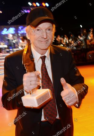 German Actor Michael Gwisdek Poses with His Premio Bacco Trophy at the Italian Film Gala 'Notte Delle Stelle' As Part of the 63rd Annual Berlin International Film Festival Aka Berlinale in Berlin Germany 15 February 2013 During the Gala the Premio Bacco Award is Presented by Italian Film Critics at Hotel Maritim Berlin Germany Berlin
