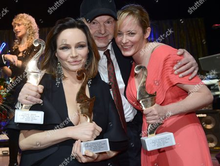 Stock Image of Italian Actress and Producer Francesca Neri (l) and German Actors Michael Gwisdek and Silke Bodenbender Pose with Their Premio Bacco Trophy at the Italian Film Gala Notte Delle Stelle As Part of the 63rd Annual Berlin International Film Festival Aka Berlinale in Berlin Germany 15 February 2013 During the Gala the Premio Bacco Award is Presented by Italian Film Critics Germany Berlin