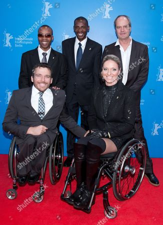 Stock Image of (l-r) the Athletes Kurt Fearnley From Australia Henry Wanyoike From Kenya Joseph Kibunya From Kenya and Kirsten Bruhn From Germany and South African Director Michael Hammon Arrive For the Premiere of 'Gold - You Can Do More Than You Think' (gold - Du Kannst Mehr Als Du Denkst) During the 63rd Annual Berlin International Film Festival in Berlin Germany 15 February 2013 the Movie is Presented in the 'Berlinale Special' Section at the Film Festival Running From 07 to 17 February Germany Berlin
