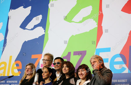 The Internationale Jury with (l-r) Cinematographer Ellen Kuras (usa) Actor Tim Robbins (usa) Director Shirin Neshat (iran) Jury President and Director Wong Kar Wai (china /hong Kong) Director Susanne Bier (denmark) Director Athina Rachel Tsangari (greece) and Director Andreas Dresen (germany) Pose at a Pressconference During the 63rd Annual Berlin International Film Festival in Berlin Germany 07 February 2013 the Berlinale Runs From 07 to 17 February Germany Berlin