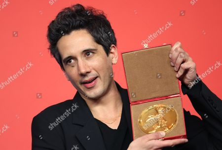 French Director Jean-bernard Marlin Poses with His Golden Bear of the International Short Film Jury For the Film 'La Fugue' (the Runaway) During a Press Conference After the Closing Ceremony of the 63rd Annual Berlin International Film Festival in Berlin Germany 16 February 2013 the Berlinale Runs From 07 to 17 February Germany Berlin