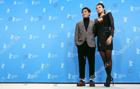 Chinese Actors Zhang Ziyi (r) and Tony Leung Chiu Wai (l) Pose at the Photocall For 'The Grandmaster' (yi Dai Zong Shi) During the 63rd Annual Berlin International Film Festival in Berlin Germany 07 February 2013 the Movie Has Been Selected As the Opening Film For the Berlinale and is Running in the Offical Section out of Competion the Film Festival Runs From 07 to 17 February Germany Berlin
