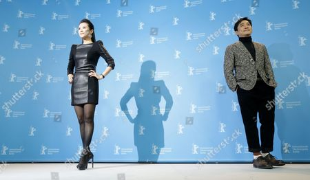 Chinese Actors Zhang Ziyi (l) and Tony Leung Chiu Wai (r) Pose at the Photocall For 'The Grandmaster' (yi Dai Zong Shi) During the 63rd Annual Berlin International Film Festival in Berlin Germany 07 February 2013 the Movie Has Been Selected As the Opening Film For the Berlinale and is Running in the Offical Section out of Competion the Film Festival Runs From 07 to 17 February Germany Berlin