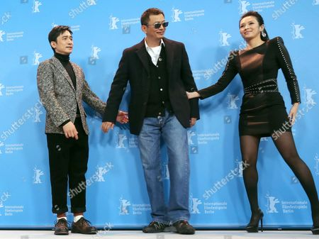 Chinese Actors Zhang Ziyi (r) and Tony Leung Chiu Wai (l) and Chinese Director Wong Kar Wai (c) Pose at a Photocall For Their Movie 'The Grandmaster' (yi Dai Zong Shi) During the 63rd Annual Berlin International Film Festival in Berlin Germany 07 February 2013 the Movie Has Been Selected As the Opening Film For the Berlinale and is Running in the Offical Section out of Competion the Film Festival Runs From 07 to 17 February Germany Berlin