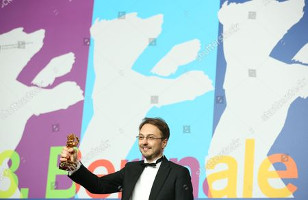 Romanian Director Calin Peter Netzer Poses with the Golden Bear Award For Best Film For His Movie 'Pozitia Copilului' (child's Pose) During a Press Conference After the Closing Ceremony of the 63rd Annual Berlin International Film Festival in Berlin Germany 16 February 2013 the Berlinale Runs From 07 to 17 February Germany Berlin