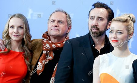 German Actors Janin Reinhardt and Uwe Ochsenknecht and Us Actors Nicolas Cage and Emma Stone Pose at a Photocall For 'The Croods' During the 63rd Annual Berlin International Film Festival in Berlin Germany 15 February 2013 the 3d Animated Movie is Presented in Competition out of Competition at the Berlinale Running From 07 to 17 February Germany Berlin