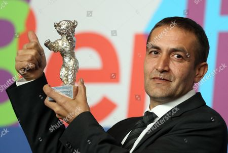 Bosnian Actor Nazif Mujic Poses with His Silver Bear Award For Best Actor For His Performance in the Movie 'Epizoda U Zivotu Beraca Zeljeza' (an Episode in the Life of an Iron Picker) During a Press Conference After the Closing Ceremony of the 63rd Annual Berlin International Film Festival in Berlin Germany 16 February 2013 the Berlinale Runs From 07 to 17 February Germany Berlin