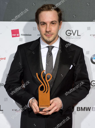 Austrian Actor Florian Teichtmeister Holds His Award He Received For 'Best Performance' During the Presentations of the German Actors' Award at Theater Des Westens During the 64th Annual Berlin Film Festival in Berlin Germany 10 February 2014 Germany Berlin