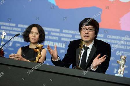 Chinese Director Diao Yinan (r) Sits Next to Chinese Producer Vivian Qu (l) As He Attends a Press Conference After Receiving the Golden Bear Award For Best Film For 'Bai Ri Yan Huo' (black Coal Thin Ice) During the 64th Annual Berlin Filmáfestival in Berlin ágermany 15 February 2014 the Berlinale Festival Runs Until 16 February Germany Berlin