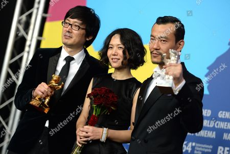 (l-r) Chinese Director Diao Yinan Chinese Producer Vivian Qu and Chinese Actor Liao Fan Pose with Their Respective Awards During the Press Conference Following the 64th Annual Berlin Filmáfestival in Berlin ágermany 15 February 2014 Diao Yinan Received the Golden Bear For Best Film and Liao Fan the Silver Bear For Best Actor Both For Their Film 'Bai Ri Yan Huo' (black Coal Thin Ice) the Berlinale Festival Runs Until 16 February 2014 Germany Berlin