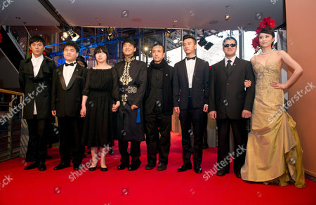 Chinese Actor Qin Hao (l-r) an Unidentified Person Actress Zhang Lei Actor Guo Xiaodong Director Lou Ye Actor Huang Xuan Actor Mu Huaipeng and Actress Lu Huang Pose As They Arrive For the Screening of 'Blind Massage' During the 64th Annual Berlin Film Festival in Berlin Germany 10 February 2014 the Movie is Presented in the Official Competition of the Berlinale Which Runs From 06 to 16 February 2014 Germany Berlin