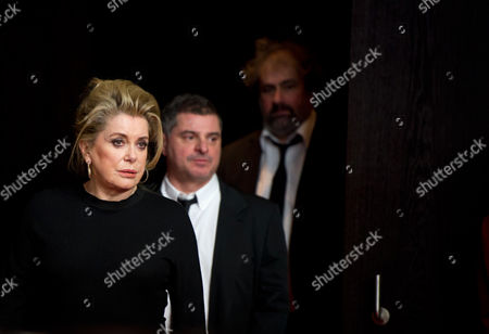 Corsica-born Director Pierre Salvadori (c) and French Actors Gustave Kervern (r) and Catherine Deneuve (l) Arrive For the Photocall 'Dans La Cour (in the Courtyard)' at the 64th Annual Berlin Film Festival in Berlin Germany 11 February 2014 the Movie is Presented in the Berlinale Special Gala Section of the Festival Which Runs From 06 to 16 February 2014 Germany Berlin
