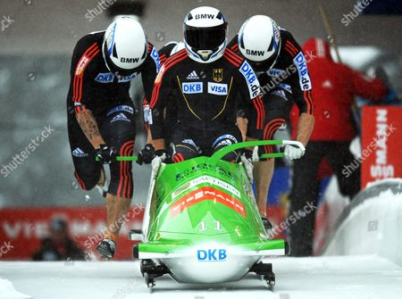 German Four-man Bob Team with Thomas Florschuetz (front) and Andreas Bredau Kevin Kuske Und Thomas Blaschek Competes During the Bobsleigh World Cup in Winterberg Germany 09 December 2012 Germany Winterberg