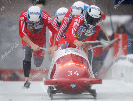 Swiss Four-man Bob Team with Beat Hefti (front) and Alex Baumann Thomas Lamparter and Juerg Egger Competes During the Bobsleigh World Cup in Winterberg Germany 09 December 2012 Germany Winterberg