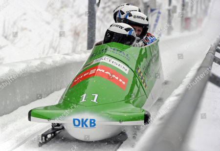 German Bobsleigh Pilots Thomas Florschuetz (front) Andreas Bredau Kevin Kuske and Thomas Blaschek Compete in the 2012 Fibt Four-man Bobsleigh World Cup in Winterberg Germany 09 December 2012 Germany Winterberg