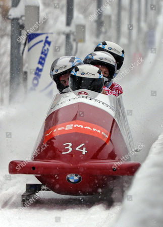 Swiss Bobsleigh Pilots Beat Hefti (front) Alex Baumann Thomas Lamparter and Juerg Egger Compete in the 2012 Fibt Four-man Bobsleigh World Cup in Winterberg Germany 09 December 2012 Germany Winterberg