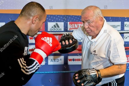 Wbo Super Middleweigh World Champion Arthur Abraham (l) Practices with His Coach Ulli Wegner During a Public Press Training in Nuremberg Germany 11 December 2012 the 32 Year Old Abraham Will Fight Challenger Bouadla From France on 15 December in Nuremberg Germany Nuremberg