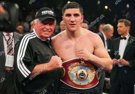 German Wbo Cruiserweight World Champion Marco Huck (r) and His Coach Ulli Wegner Pose with the Champion's Belt After Huck Beat British Challenger Ola Afolabi During Their Cruiserweight Title Bout in the Max-schmeling-halle in Berlin Huck Won the Fight to Keep His Title Germany Berlin