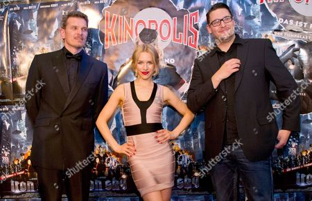 German Actress Julia Dietze (c) German Actor Goetz Otto (l) and Finnish Director Timo Vuorensola (r) Pose During the Cinema Premiere of Their Movie 'Iron Sky' in Sulzbach Hesse Germany 05 April 2012 Germany Sulzbach