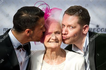 Movie Enthusiasts and Extra Johanna Penski (c) is Kissed by German Actor Kostja Ullmann (l) and Director Marco Kreuzpaintner As They Arrive For the 64th German Film Award 'Lola' Ceremony in Berlin Germany 09 May 2014 Germany Berlin