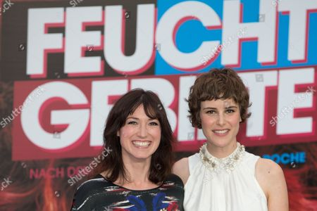 British Author Charlotte Roche (l) and Swiss Actress Carla Juri Pose For Photographers As They Arrive For the Premiere of the Movie 'Feuchtgebiete (wetlands)' at Cinestar Cinemas at Potsdamer Platz in Berlin Germany 13 August 2013 the Film Premieres in German Cinemas on 22 August 2013 Germany Berlin