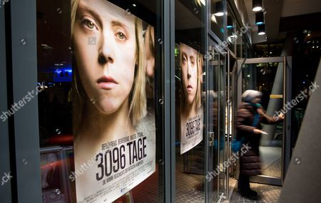 Stock Image of A Woman Leaves the Cinema Cinestar at Potsdamer Platz in Berlin Germany 27 February 2013 the Movie '3096 Days' (3096 Tage) About the Kidnapping of Austrian Natascha Kampusch was Shown Here in the Evening of the Same Day Kampusch Did not Attend the Showing in Berlin Germany Berlin