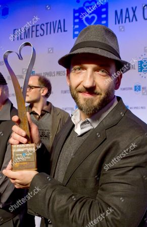 Actor Michael Fuith Holds the Max Ophuels Prize in Saarbruecken Germany 21 January 2012 He was Honored For His Role in the Film 'Michael' the Film Festival Which Honors Young German Language Films Runs From 16 to 22 January Germany Saarbruecken