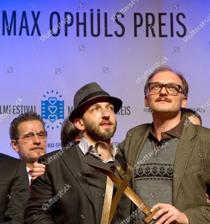 Stock Photo of Actor Michael Fuith (l) and Austrian Director Markus Schleinzer Hold Their Max Ophuels Prize in Saarbruecken Germany 21 January 2012 They Were Honored For Their Role in the Film 'Michael' the Film Festival Which Honors Young German Language Films Runs From 16 to 22 January Germany Saarbruecken
