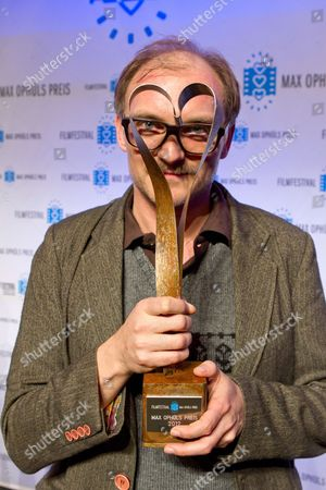 Austrian Director Markus Schleinzer Holds His Max Ophuels Prize in Saarbruecken Germany 21 January 2012 Schlenzer was Honored For His Film 'Michael' the Film Festival Which Honors Young German Language Films Runs From 16 to 22 January Germany Saarbruecken