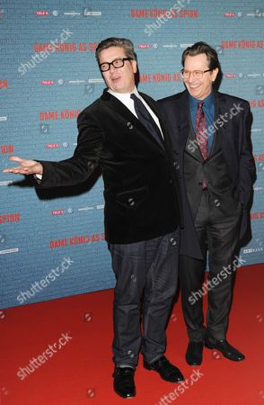 British Actor and Cast Member Gary Oldman (r) and Swedish Film Director Tomas Alfredson (l) Pose For a Photograph As They Arrive For the Premiere of the Movie Tinker Tailor Soldier Spy at the Kino International in Berlin Germany 24 January 2012 the Movie Will Be Released in German Theatres on 02 February Germany Berlin