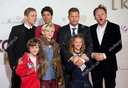Stock Image of A Picture Made Available on 30 January 2013 Shows Actors Matthias Schweighoefer (l-r) Maurizio Magno Nico Liersch Jasmin Gerat Til Schweiger Emma Schweiger and Samuel Finzi Arriving For the Premiere of 'Kokowaeaeh 2' at Cinestar Cinemas at Potsdamer Platz in Berlin Germany 29 January 2013 the Film Will Be Aired to German Cinemas on 07 February 2013 Germany Berlin