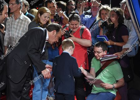 Canadian Actor/cast Member Kyle Catlett (c-rear View) Signs Autographs at the Premiere of 'The Young and Prodigious T S Spivet' During the Opening Night of the Munich Film Festival in Munich Germany 27 June 2014 the Event Runs From 27 June to 05 July Germany Munich