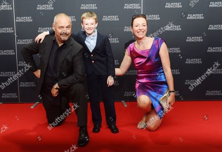 (l-r) French Director Jean-pierre Jeunet Canadian Actor Kyle Catlett the Leading Actor of the Opening Movie 'The Young and Prodigious T S Spivet' and Festival Director Diana Iljine Pose During the Opening of the Munich Film Festival at the Mathaeser Filmpalast in Munich Germany 27 June 2014 the Festival Runs From 27 June to 05 July Germany Munich