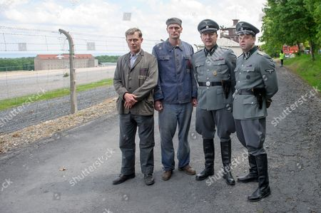(l-r) Actors Andreas Lust Ulrich Brandhoff As Prisoner Heinrich Schuepp Robert Gallinowski and Rainer Bock Stand in Front of the Former Concentration Camp Bunchenwald During a Break in the Filming of 'Nackt Unter Woelfen' (naked Among Wolves) Near Weimar Germany 26 May 2014 the Remake Based on the Book of the Same Title by German Writer Bruno Apitz who Himseld was an Inmate of the Buchenwald Concentration Camp (1937-1945) Will Be Released in Spring 2015 Germany Weimar