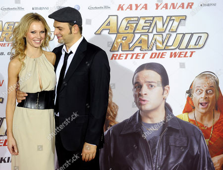 German Actor Comedian and Presenter Kaya Yanar and German Model and Actress Birte Glang (l) Pose For Pictures As They Arrive For the Premiere of the Movie 'Agent Ranjid Save the World' in Cologne Germany 17 October 2012 the Movie Will Be Released in German Theatres on 18 October 2012 Germany Cologne